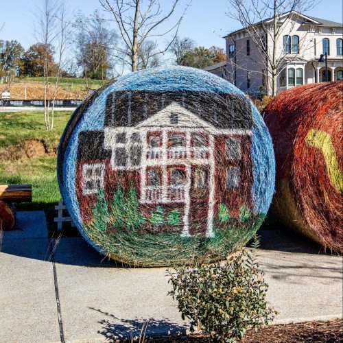 homes painted on hay